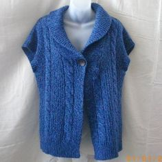 This tweedy blue cardigan has short sleeves, a shawl collar and one large button as closure. There is a cable design down the front, and the back is in ribbing. Size M, this garment measures 42 around the bust unstretched rib is chunky and str...