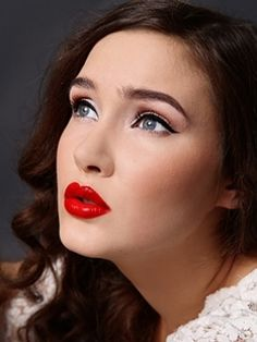 retro look winged liner and red lipstick