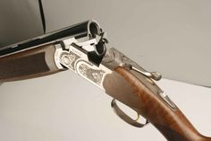Beretta 686 Silver Pigeon Over/Under.  Silver Pigeon I Sporting is the preferred model for clays.  There's also a Silver Pigeon III, V and EELL which offer improved wood, engravings, etc. but are otherwise the same product.  Street Prices for the I, III, V, EELL are:  $2000, $3000, $4000, $ARM+LEG