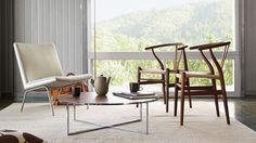 WISHBONE CHAIR Denmark  1950 — Hans J. Wegner  The perennially bestselling Wishbone Chair is light, strong, simple, and supportive with its lyrical wishbone-shaped back. The paper yarn woven seat is comfortable and ultra-durable. A chair that creates its own atmosphere.  Lacquer and oil finishes on ash, walnut, oak, cherry Paint finish on beech Black or natural hand-woven papercord seat