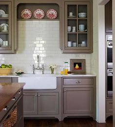 Warm/taupey cabs with subtile bsplash and two coordinating counters...LoveLoveLOVE it...