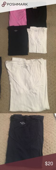 LOT of 4 V-Neck T-Shirts Pink, white and Navy are J. Crew & the black one of Madewell. Small hole in the back of the pink one. Selling as is to make some room in my closet!! J. Crew Tops Tees - Short Sleeve