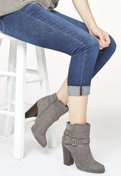 Xiomara is the sexy and cool boot you've been looking for. With a stacked block heel and buckle strap detail, she's sure to take you from summer to fall in perfect fashion. Featuring a faux suede construction....