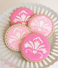 from glorious:  Pink Damask Cookies-    Inspired by several of my flickr cookie mentors, I've been wanting to try stenciling for some time. I finally found a chance this week. I found a clip art damask pattern on-line that I liked, and then cut out my own stencil.