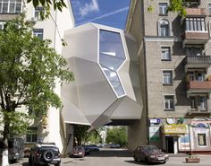 Za Bor Architects have built Parasite Office, which hangs between two existing buildings without disrupting the traffic flow below.