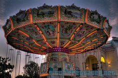 This beautiful Merry-go-round in Vienna, Austria is located at the entrance of Prater, one of Europe's most famous fairground.  Do you like old-style carousels or do you fancy high-tech themeparks?