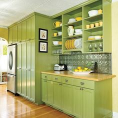 I love kitchens with wood floors, and I love how they did the colors green and yellow.