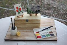 Watercolour Painting Cake Watercolour Painting Cake The box is ginger cake with orange buttercream filling. I handpainted the box and board (covered in fondant) with... #watercolor #painting #cake-hand-painted #cakecentral
