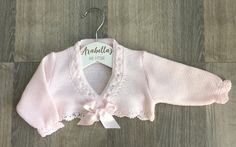 fc8eab9eb Baby pink knitted bow cardigan with lacey style edge, bolero Spanish girls  wear Arabellas baby boutique