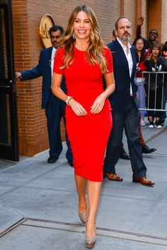short sleeved red dress / nude heels / statement earrings / sofia vergara