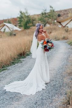Beautiful bride with purple hair and lace dress and long train with veil and boho bridal bouquet in this styled shoot by Kristi Alyse Photography in Logan Utah. boho wedding flowers orange blue bridal bouquet lace white dress long train veil northern utah meaningful photography quality photography wedding and family photography purple hair #northernutahweddingphotographer #loganutahweddingphotographer #meaningfulphotography #bohowedding #bohoweddingdress #utahweddings #bridalbouquet #love…