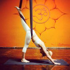 AIReal Yoga crochete split.  A stretching inversion, calming the mind, decreasing inflammation and helping to relieve stress and anxiety.  Airealyoga.com #yoga #aerialyoga