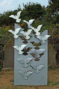 Love the way the bird seems to appear from nothing at the bottom the gradually flies away.#metal # art #sculpture