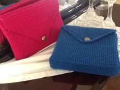 pink and blue clutch bags