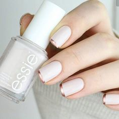 To bump up the typical French manicure, opt for a base coat of a neutral polish + then top it off with rose gold tips.