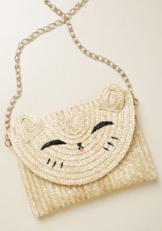 Look at that face!  Mom really wants this straw envelope clutch with pearls and gold chain.  Purrs.