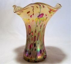 Glass Eye Studio hand blown art glass vase Pale beige yellow with chartreuse green and red mosaic spots, peacock blue green swirls, and an oil slick iridescent coating, gorgeous Ruffle top Made with Mount St Helens ashes 6.5 inches tall, 5.5 wide at mouth, 3 wide at base Original paper label reads Glass Eye made in USA Very good condition, I see no chips, scratches, cracks International buyers welcome 020117   Credit Cards and Paypal accepted