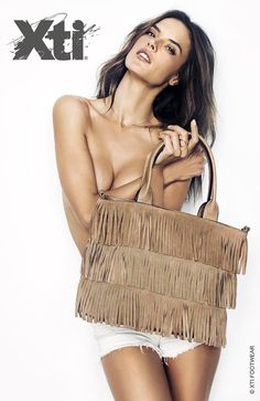 aa4f80a08a13 Alessandra Ambrosio goes topless as she poses with a fringe embellished bag  for XTI s spring 2016