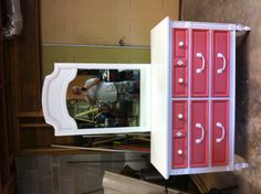 Idea for Ava and KK's dresser. Cream for base of dresser and fun pop of color for drawers. No mirror.