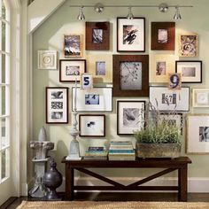 create a vignette using photos, interesting furniture and plants or other objects