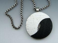 Contemporary textured black and white polymer clay pendant by Stonehouse Studio