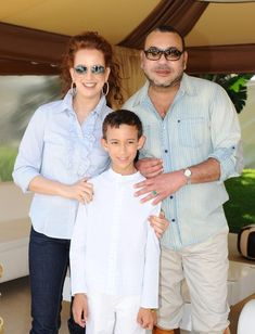 Prince Moulay Hassan flanked by his proud parents, King Mohammed VI and Princess Lalla Salma.