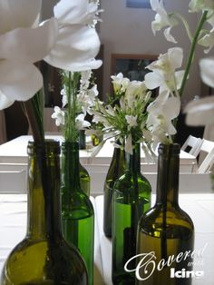 Use wine bottle for a vase in kitchen! :)