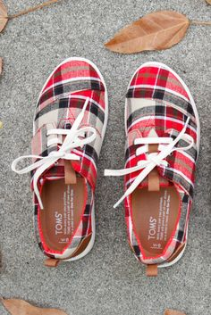 Nothing says fall more than red plaid shoes. Keep it seasonal in TOMS Slip-ons and Lace-ups.
