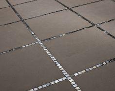 1x1 mosaic accents running between 12x12 floor tiles.
