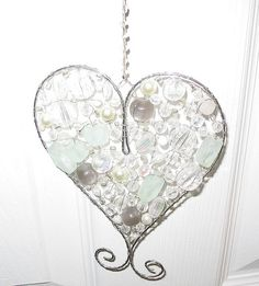 White bead heart    A pretty silver wire heart with lots of pebble beads and sea glass    Love Stitching Red and Carolyn Saxby - Mixed Media Textile Art