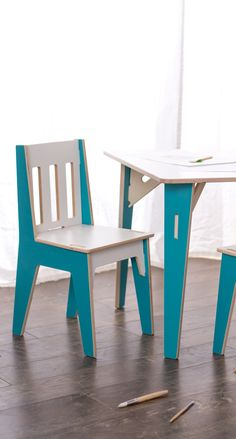 Adorable Wood Kids Table and Chair set. Make the living room the playroom. Aqua and white table set. Love the cute and fun blue!
