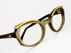 Vintage Beige Cat Eye Eyeglasses Sunglasses Eyewear Frame With Gold Brow Accents NOS. $89.00, via Etsy.