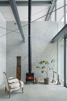 House in Sakurashinmachi / Comma Design #fireplace