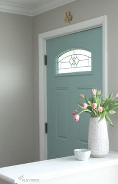 Bringing your front door's exterior color inside and using a predominant color from your home decor.