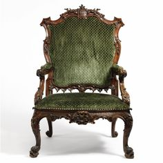 A GEORGE II CARVED MAHOGANY OPEN ARM CHAIR BEARING THE BARRINGTON ARMS, ATTRIBUTED TO JOHN LINNELL, circa 1755.