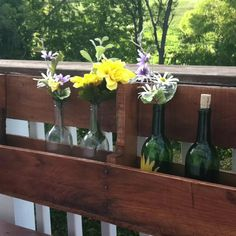 Homemade wine bottle holder from pallets. My husband is so crafty!
