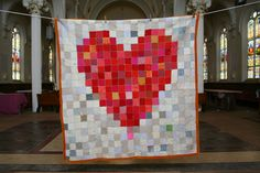 pixellated heart blanket, made from recycled sweaters.