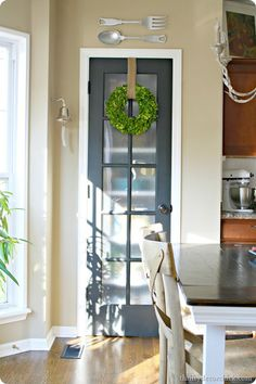glass pantry door and the wreath on it