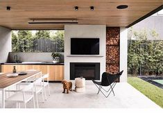 The perfect outdoor entertaining space. and I'll take one of the cute puppy too please 🐶 Brighton 5 by Styling… Outdoor Bbq Kitchen, Outdoor Kitchen Design, Patio Design, Outdoor Living Rooms, Outdoor Dining, Parrilla Exterior, Balkon Design, Outdoor Areas, Outdoor Entertaining