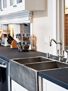 Love this stainless steel textured apron front sink. - Kitchen Countertops: Colors and Materials on HGTV