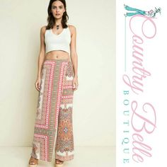 FLASH SALE  walk on the beach skort This season's trendy Walk On The Beach pants are these skort style cut  in a maxi length!  With a pretty print in shades of coral and ivory, these wide legs flowy pants feature a cross over wrap front with an easy stretch waist. Pair these with a bright colored crop top for the perfect For a walk on the beach Skirts Maxi