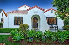 Spanish Cottage     in Los Angeles   pretty details to this cottage under a red tile roof     golden light comes through the windows   stri...