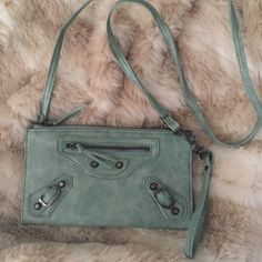 ❗️SALE❗️CrossBody Purse Seafoam color NEVER USED BRAND NEW. Crossbody purse. Seafoam color. Unsure of the brand, I bought it when I was traveling. Two pockets inside and one in the back. Perfect for going out! Feel free to make an offer using the offer button 😊 N/A Bags Crossbody Bags