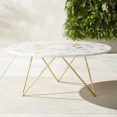 Capiz-covered coffee table adds seaside romance to the outdoors or brings the ocean vibes in. Three brass finished hairpin legs add a modern air to this natural beauty. Coffee Table Cover, Marble Top Coffee Table, Unique Coffee Table, Modern Coffee Tables, Outdoor Tables, Al Fresco Dining, Engineered Wood, Dining Table, Furniture