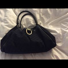Authentic Gucci handbag Prestige condition. Black with dust bag. I do not set my handbags on the floor. Has one minute blemish as seen in pic. Gucci Bags