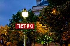 "Paris Fine Art Photograph: ""Le Metro"". Captured on a warm summer evening, even as darkness cloaked the city, the Metro sign was a welcome beacon."