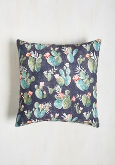 No extravagant explanation is needed for you to understand the awesomeness of this patterned pillow! Prickly pear cacti cover this grey cushion, bringing simple joy to your space.