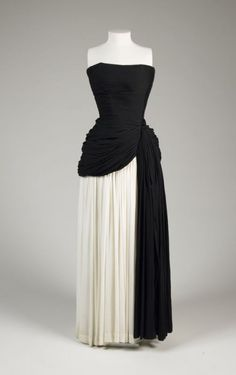Evening dress Madame ( Alix ) Grès c.1950 Pleated and draped, classical in style. Strapless bodice and overskirt drape in black over underskirt of ivory