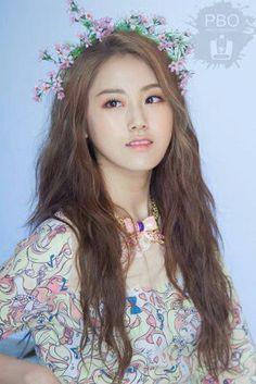 Long natural wavy hair. Flower crown. Kpop fashion.