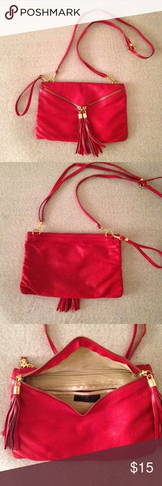 Vintage Red Leather Purse Super cute vintage red leather purse Made in Italy. Zips up diagonally with gold accented tassels. Normal wear on the bag. On the back its a little bit darker than the front but I'm sure can be cleaned up. Corners are shown in pictures! Bags Crossbody Bags